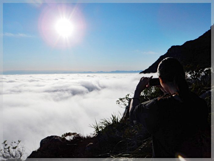 Taking a photo of Sea of Cloud around Table Mountain