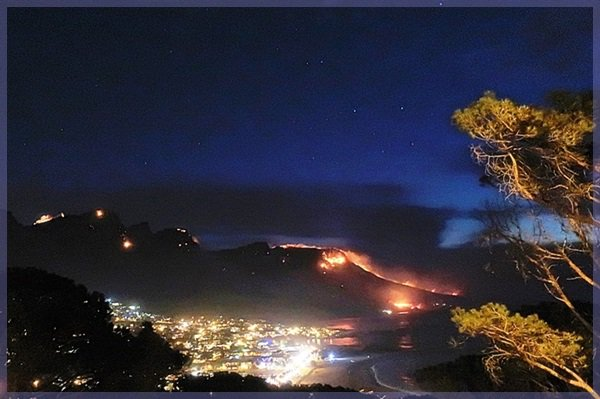 Nigh shot of Table Mountain's Twelve Apostles on fire October 2017