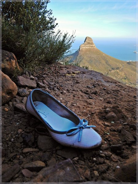 Woman's Pump shoe found on Table Mountain trail with Lion's Head in background
